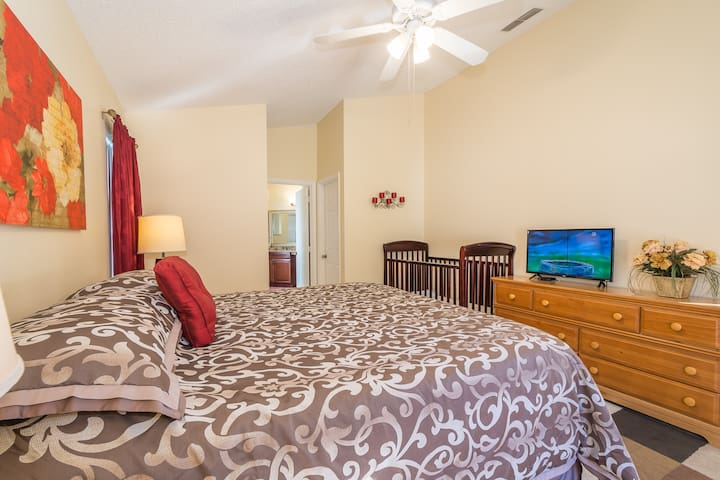 King Size Master Bedroom with a Crib