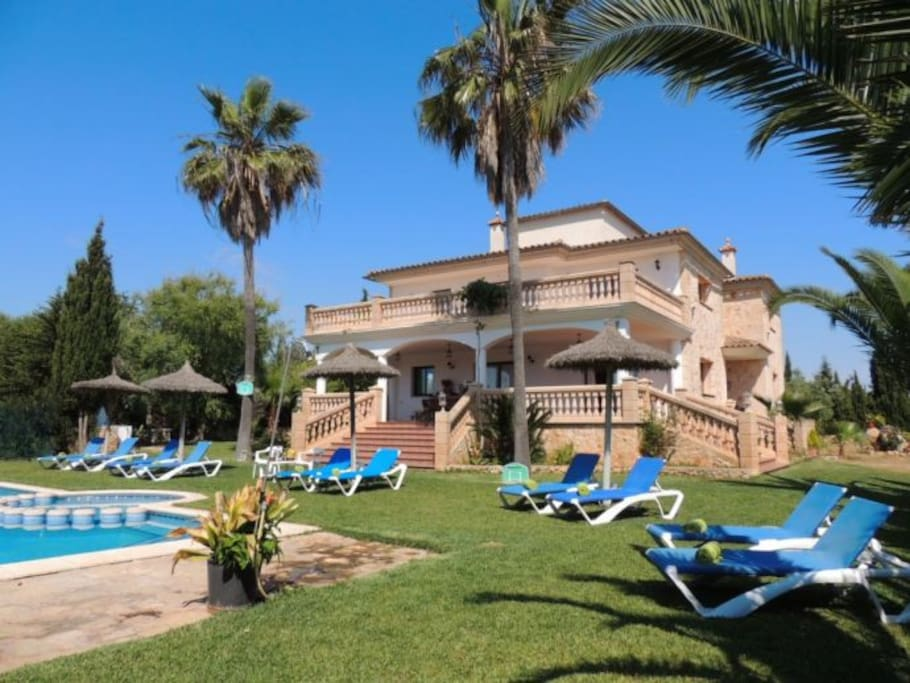 Pool area with comfortable sun loungers and umbrellas