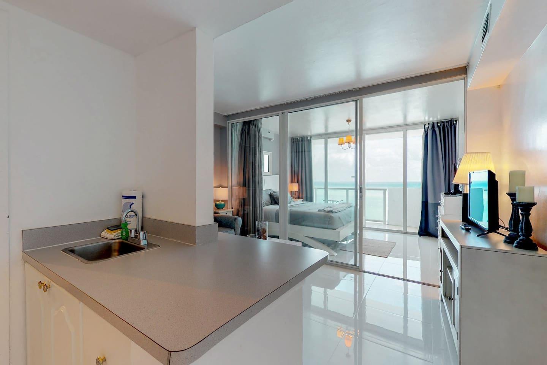 Beachfront condo with ocean views, a resort pool, tennis & fitness center!