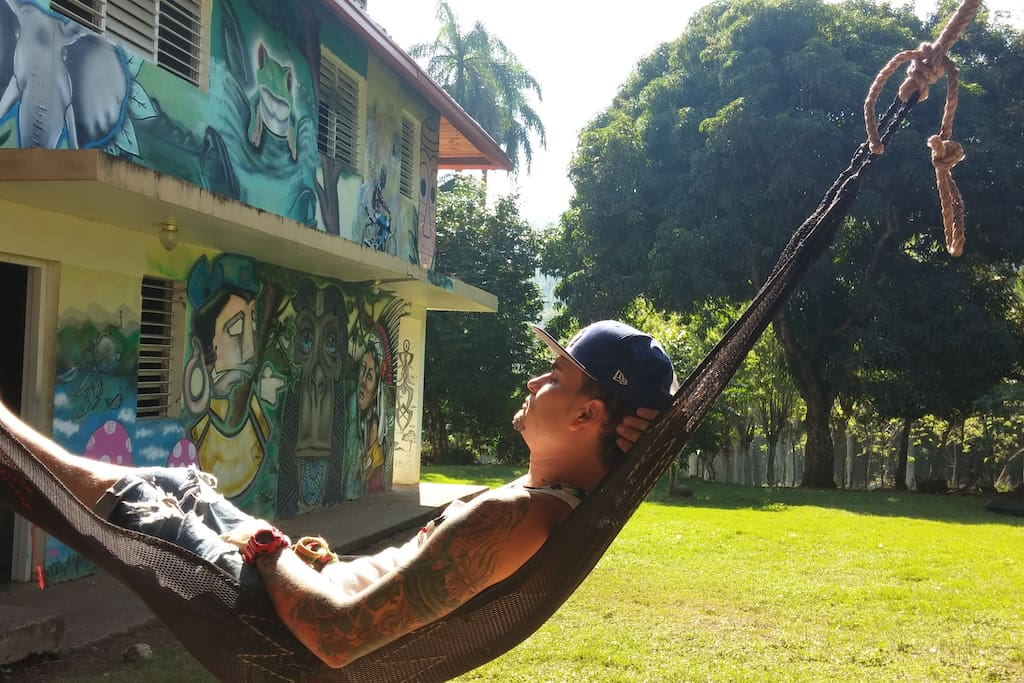 Suavecito! Our villa crew member J relaxing after hard day's work. Notice the mango and star fruit trees in the back...;}