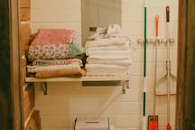 Laundry room area with closet space and sink.