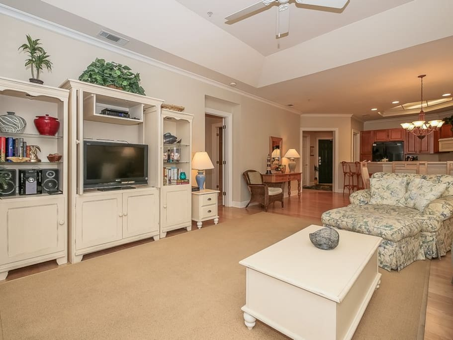 Living Room Opens to Dining Area and Kitchen at 8114 Wendover Dunes