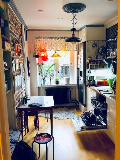 The cozy kitchen open up the window and hear the birds sing...