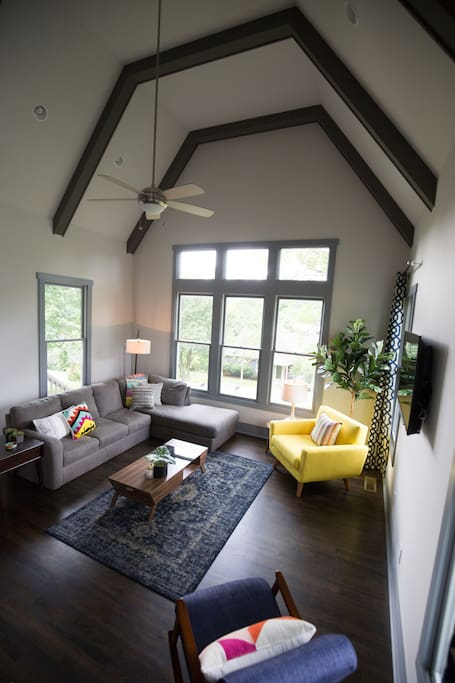 Entertainment central. Large living room with soaring vaulted ceilings