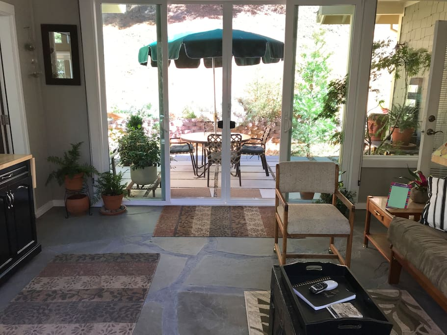 Enclosed sitting room and outdoor patio for your use
