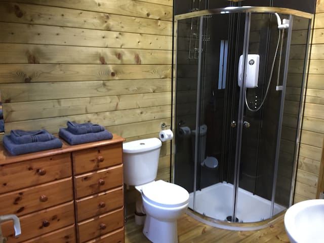 The bathroom is en suite to the bedroom, but also has an separate door so that it can be accessed without having to go through the bedroom should another guest be staying on the single floor mattress in the living room.