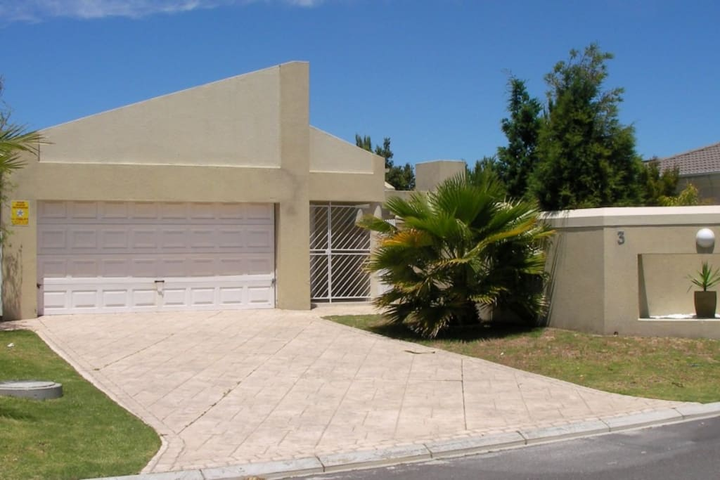 front of house with double garage and drive