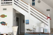 Stairs to sleeping loft containing twin beds