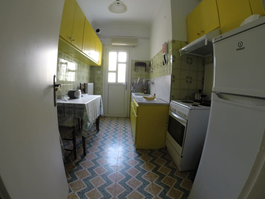 A sunny, spacious kitchen fully equipped for making meals