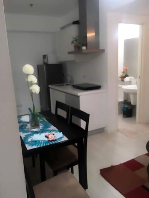 4 seater dining table with fully furnished kitchen
