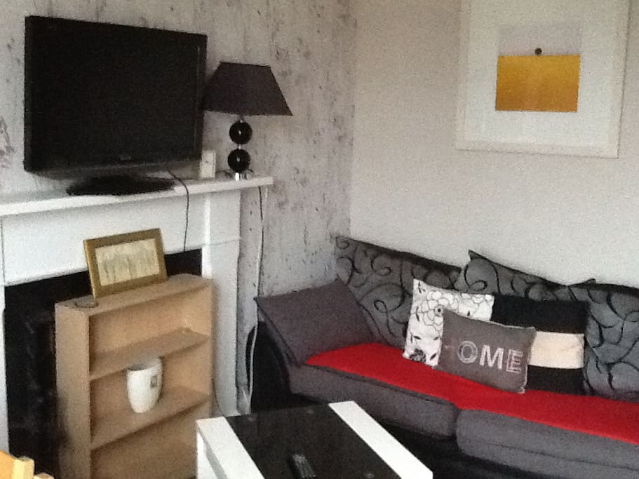 Lounge on first floor with large flat screen TV.  2&3 seater settees