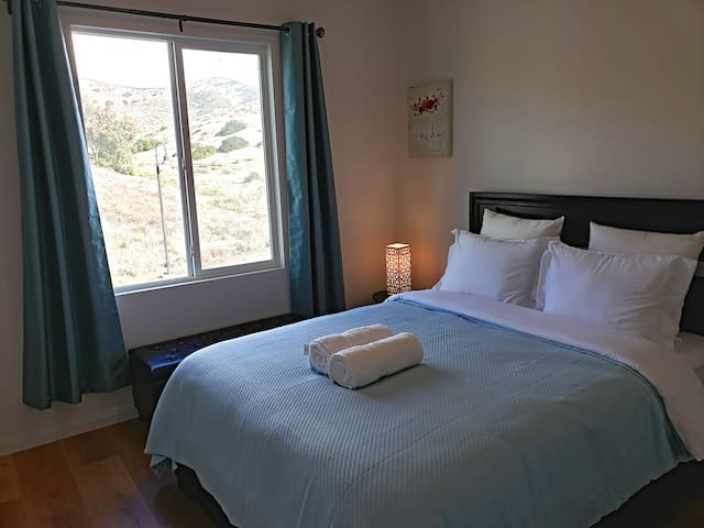 Comfy Bedroom with Mountain View