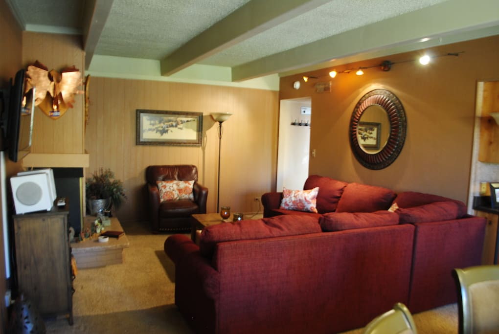 Open spacious living room with fold out sofa.