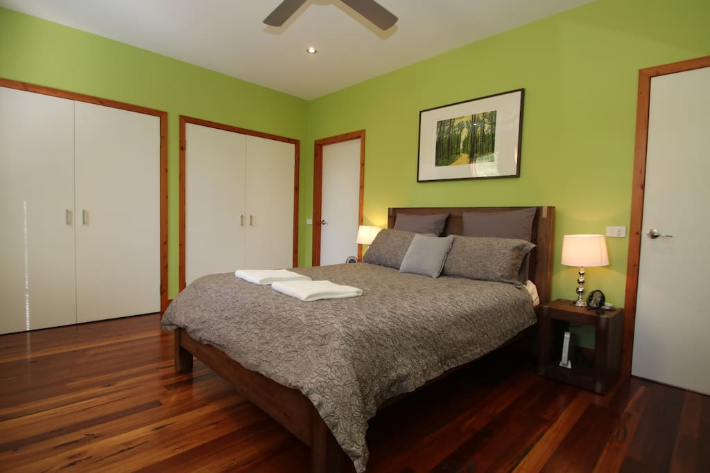 Bedroom 1. Queen bed with large built in robes and mirrored dresser. Direct access to shower and toilet.