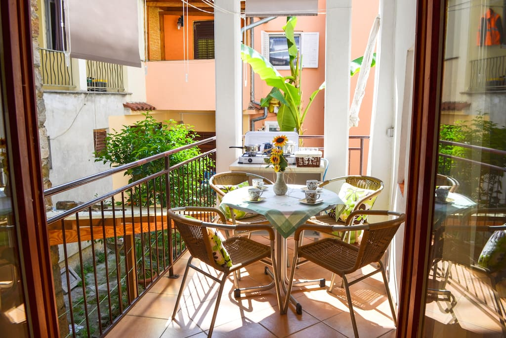 Sunny balcony with sitting/dining area