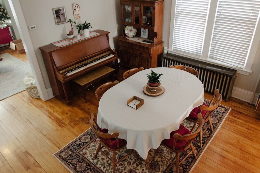 Enjoy a meal around the table in the dining room.