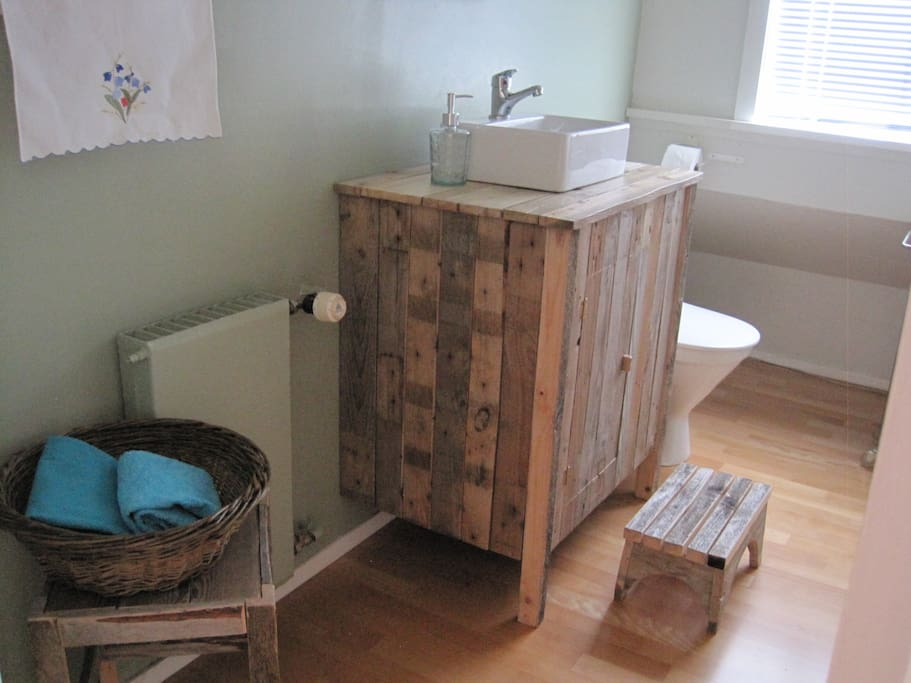 We enjoy recycling and repurposing material. Here we've made bathroom furniture out of old timber.