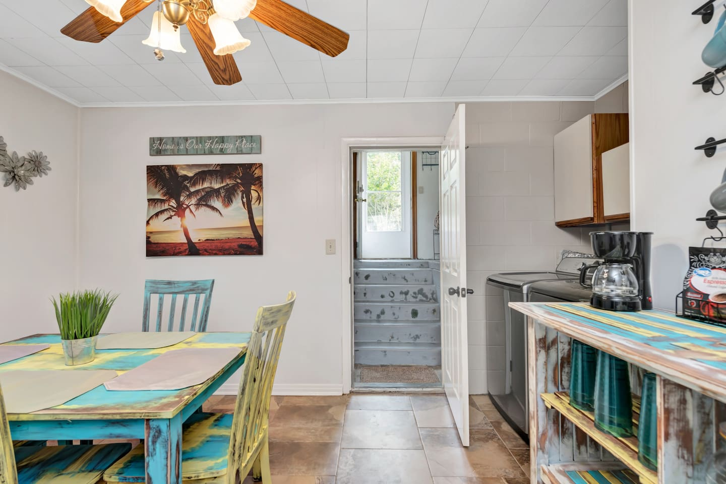 Dining Table in Kitchenette with washer and dryer available for guest use!