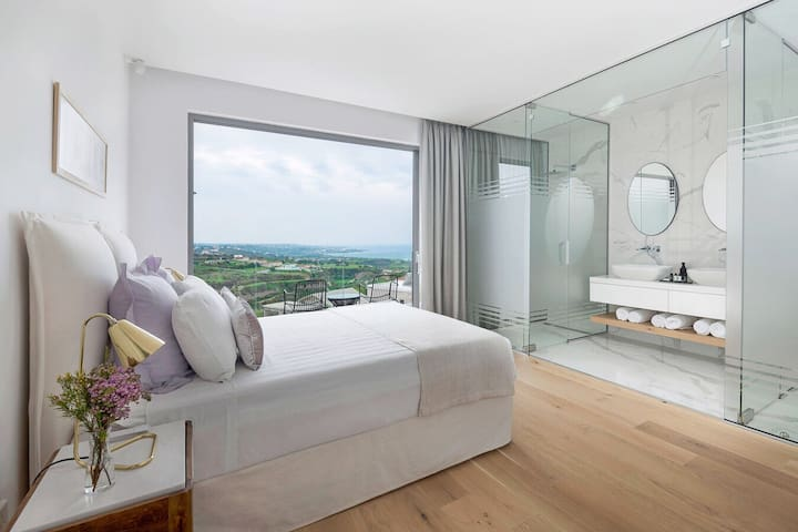 Master Bedroom with mountain and sea view