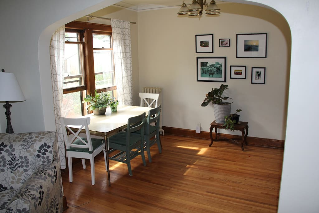 A large, arched doorway connects the living room to the dining room.