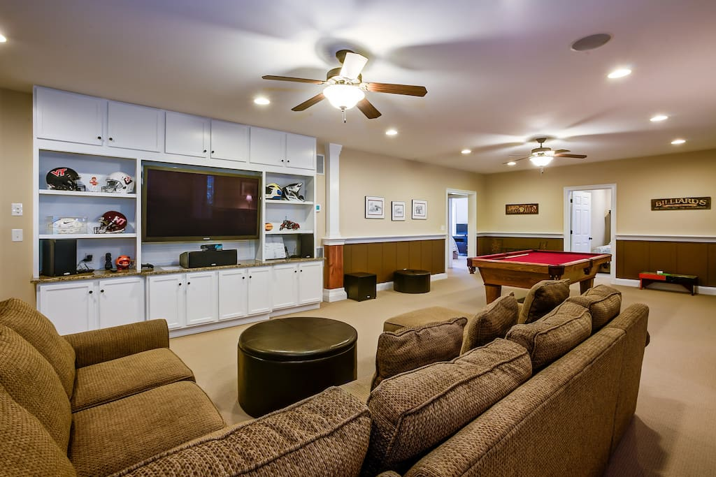 Entertainment area with surround sound, pool table and bar