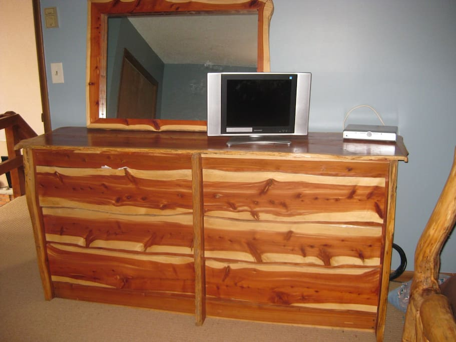 Master dresser with pine furniture and TV