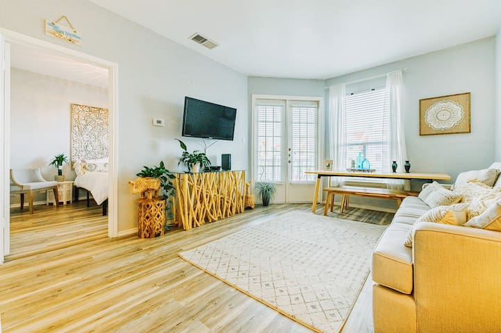 Living room includes a queen-sized sleeper sofa, cable tv, and dining table/benches that can be pushed out of the way when not in use.