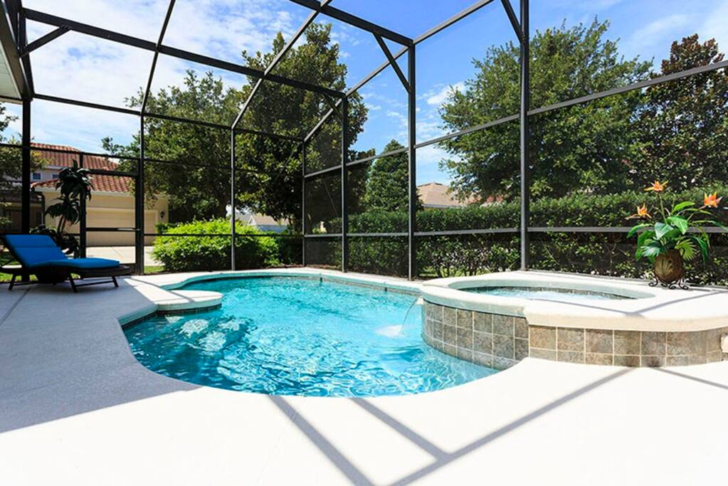 Enjoy your private screened-in pool and spa situated on a large corner lot