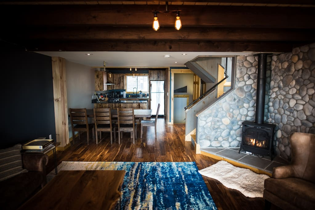 looking from living room to dining room to kitchen - cozy Vermont Casting propane fireplace