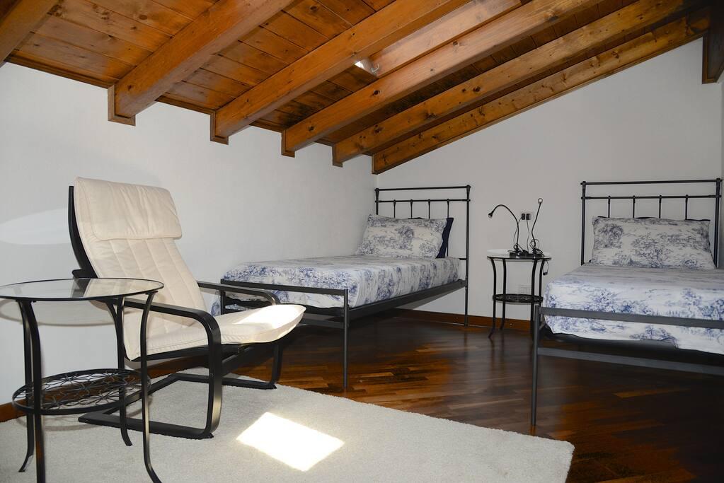 attica apartment twin bedroom