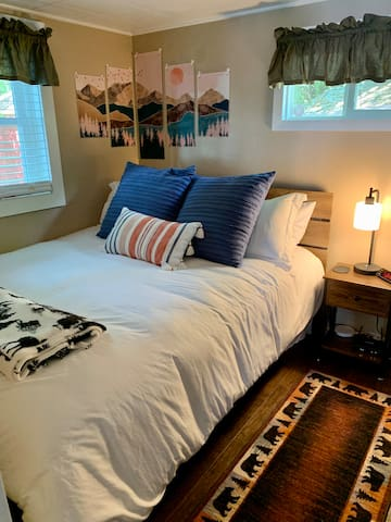 Make yourself at home in the private bedroom with queen size bed