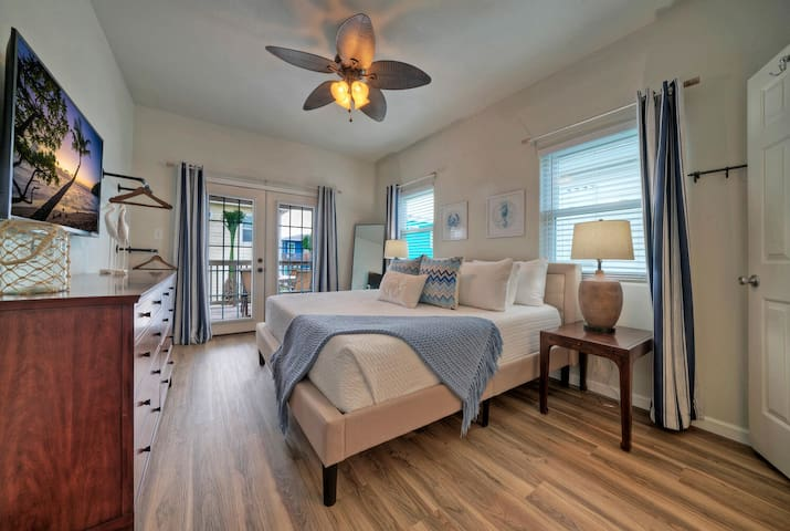 Master suite with ensuite bath.  King Bed.  Opens to the back deck.