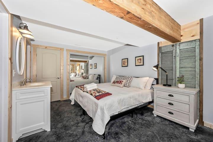 Basement bedroom 2 - with full bath. 1 king 3 twins