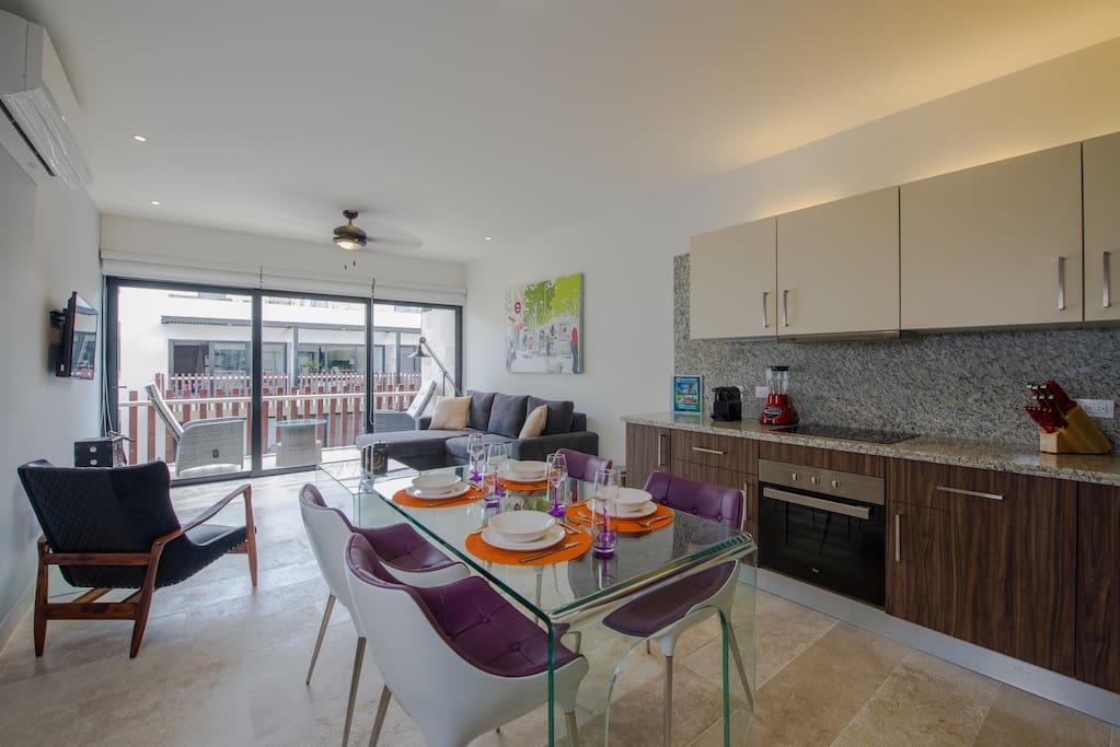 Fully equipped kitchen with stainless steel appliances and dining area