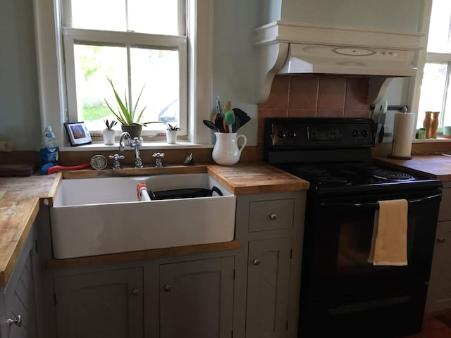 Our kitchen is the heart of the home! With a large bar top seating area, farmhouse sink and butcher block counter space, its perfect for hosting a traditional Island lobster feed!