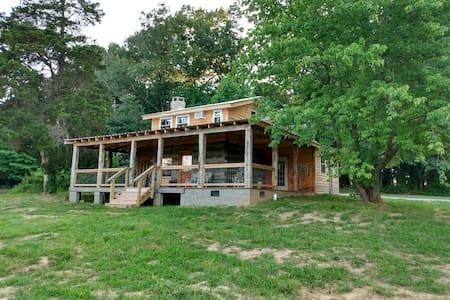 Aunt Jane's: restored log cabin on 230 acres