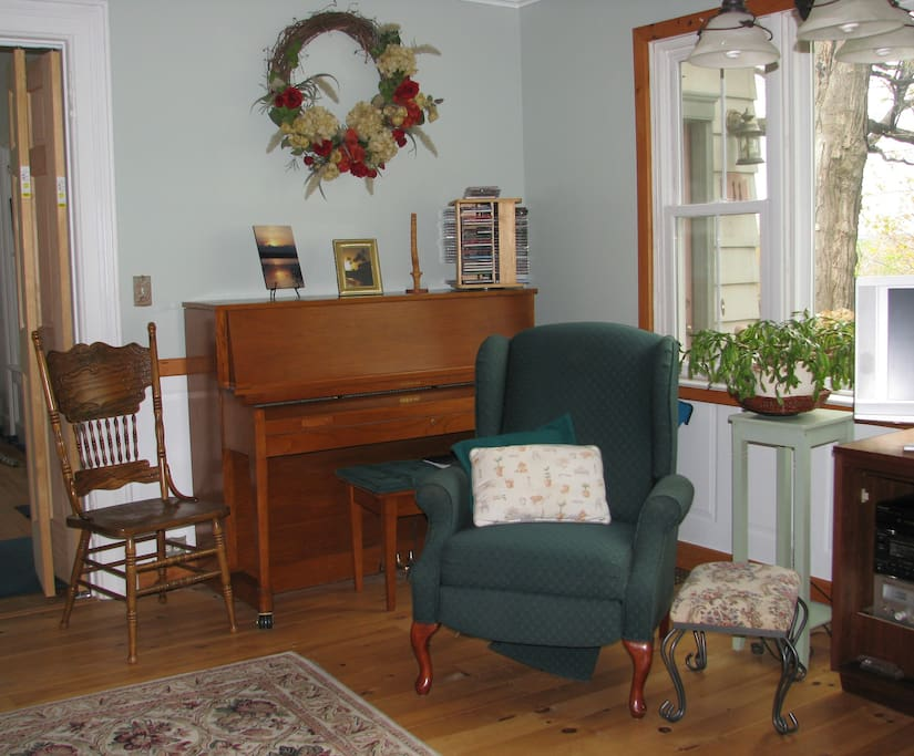 Comfy chair and piano.