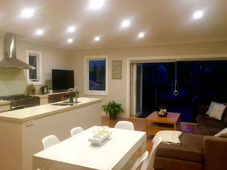 Open plan living, dining, kitchen and lounge room (55 inch, Samsung smart TV)