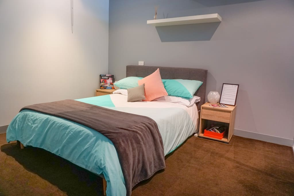 Clean and bright bedroom with a double bed