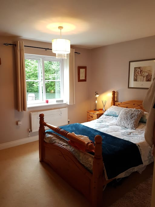 Double bed with opurest mattress ,room has a beautiful garden view overlooking woodland .
