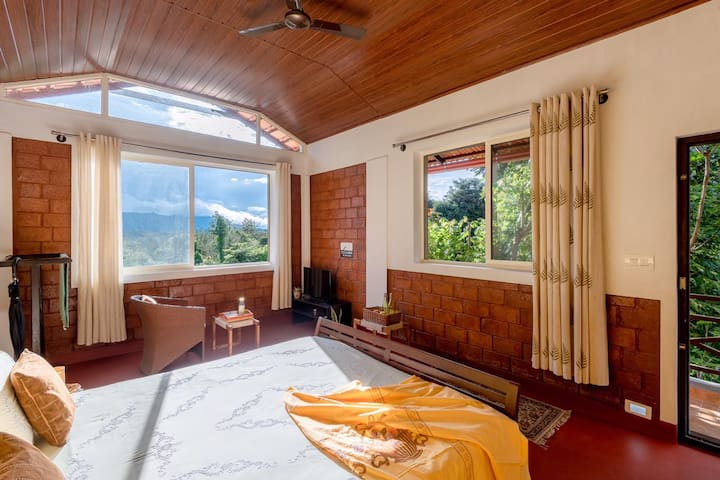The top-end lovely sunset guest room with fantastic views of the Brahmagiri hills and forest