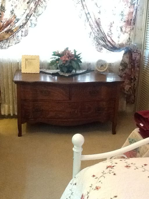 Your view from the bed. Large dresser for your items. Great for long term guests.