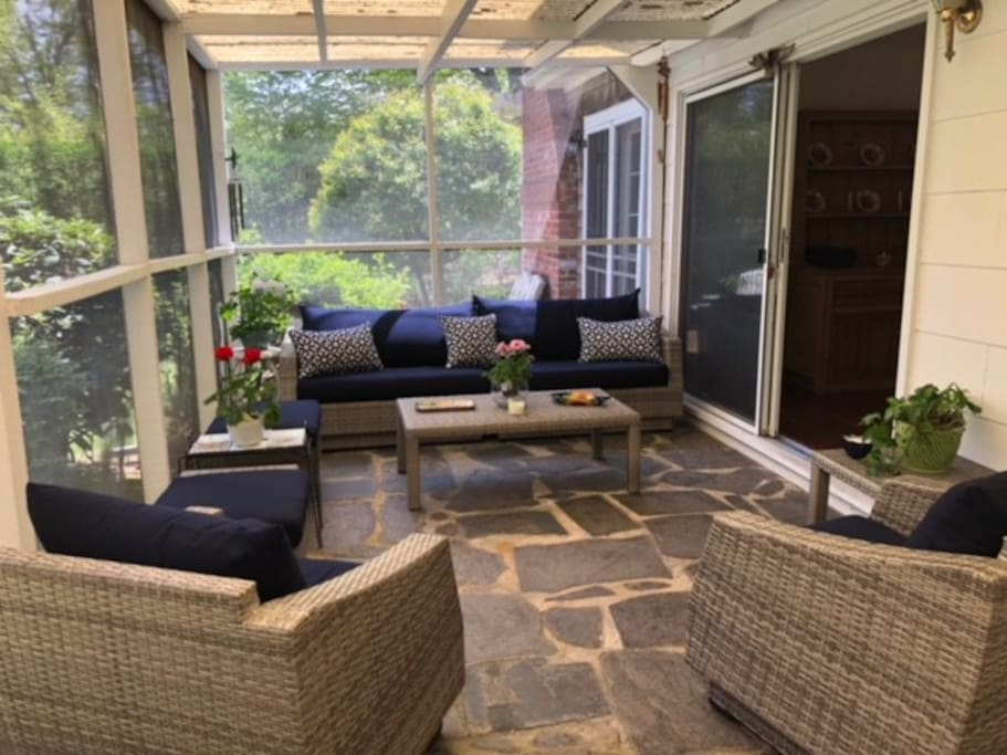 Comfortable screened in porch with dining area