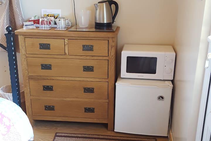 Tea coffee making facilities and a mini fridge freezer and a microwave