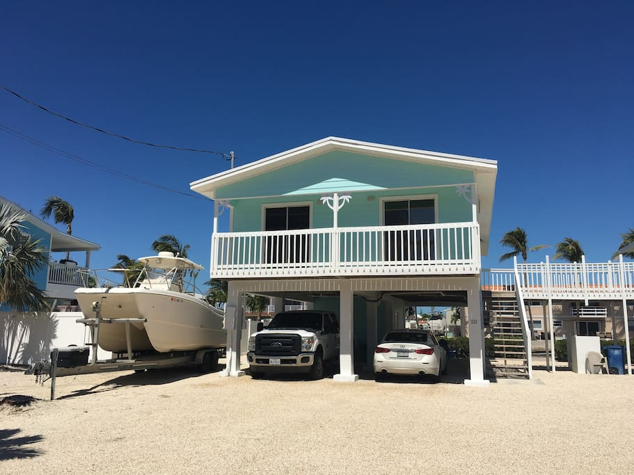 Front of home. Covered parking for up to 3 vehicles & additional space for boat trailers.