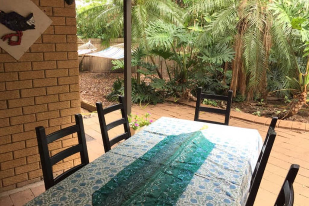Your outdoor courtyard and BBQ area with table & chairs, hammocks in background.