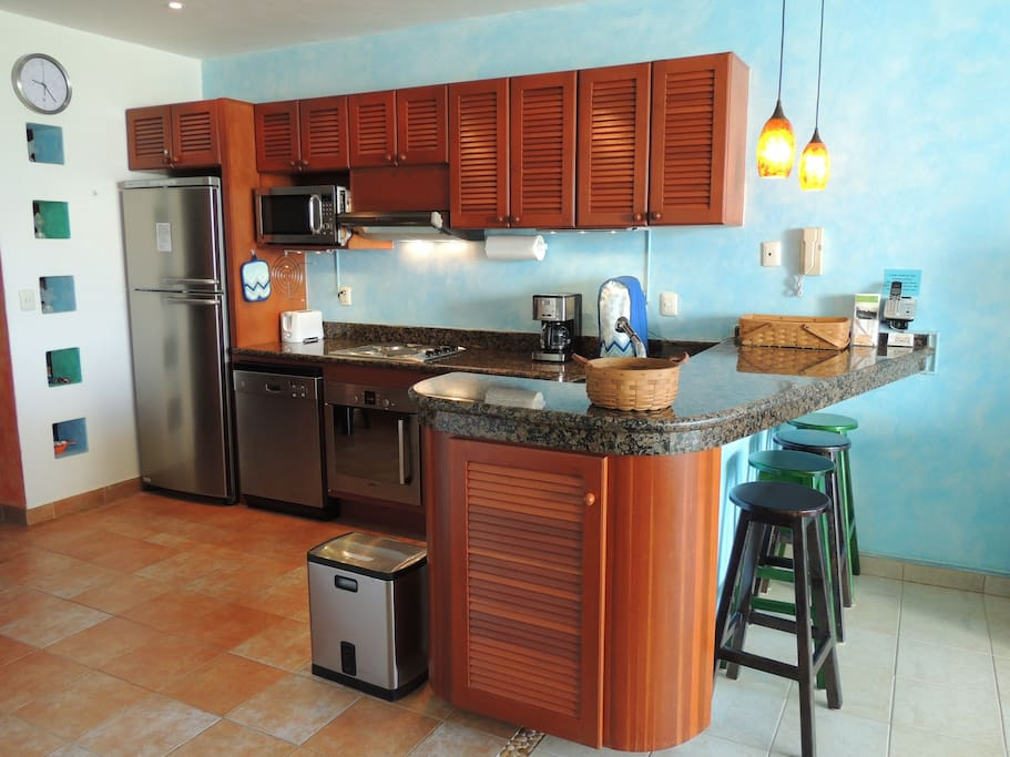 Modern kitchen with granite countertop.  All  appliances and cooking utensils supplied.