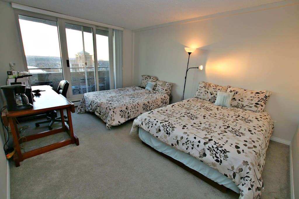 Spacious room with two queen bed, private balcony and   Coffee machine, filtered water, kettle, microwave all right in your room.   Supplementary Starbucks coffee and tea.