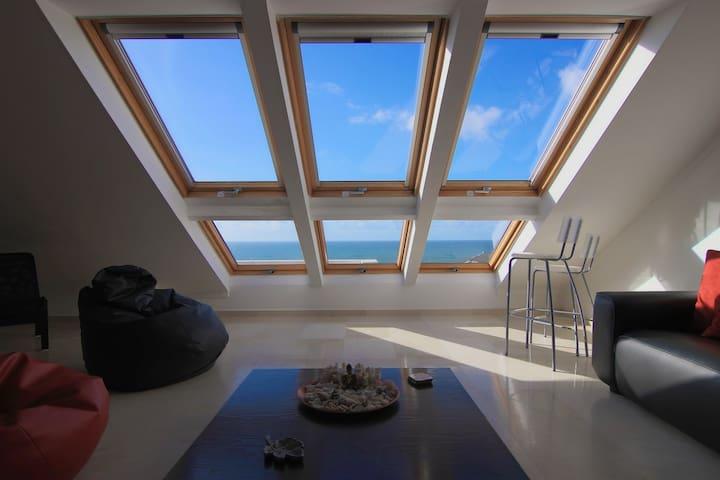 Top floor loft with beach & sea view