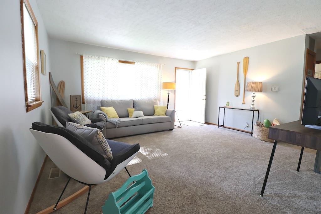 """With brand new furnishings, 32"""" TV, and DVD player, you'll love relaxing in main living area."""